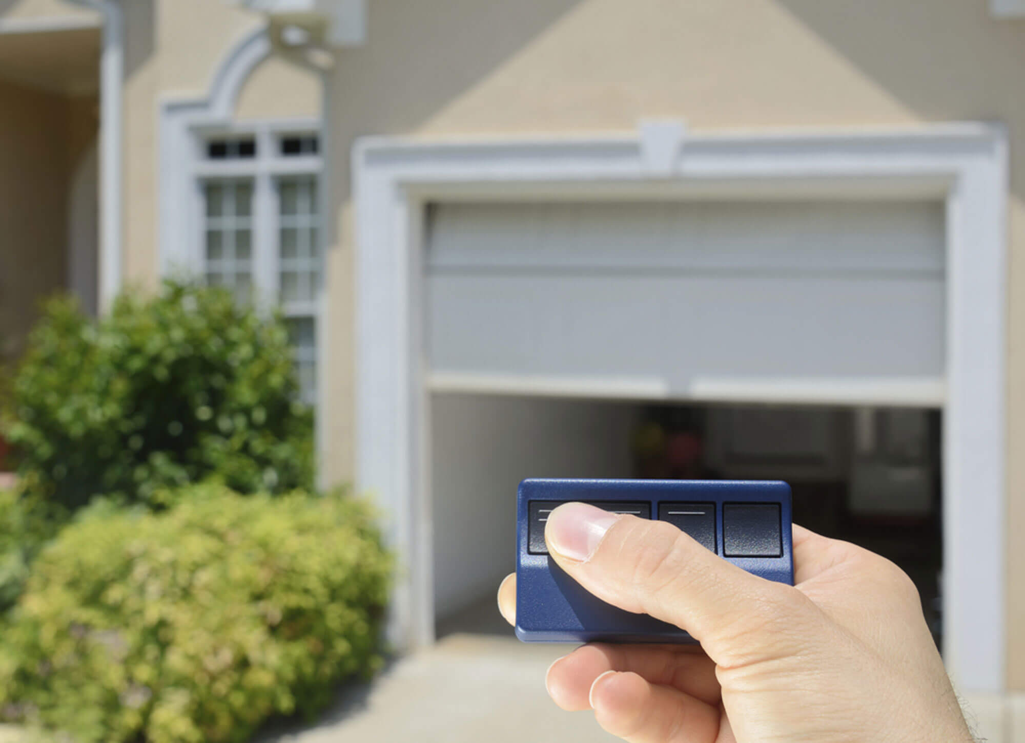 Common Reasons Your Garage Door Opens On its Own